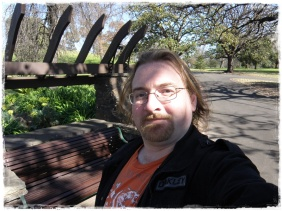 A selfie in front of a bench I used to sleep on when I became homeless in 2009...